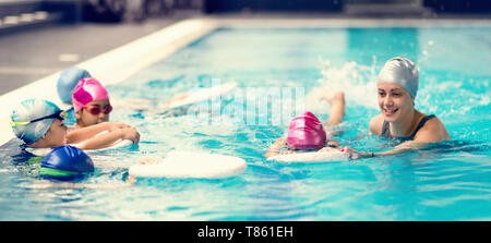 Group swimming lesson - Stock Photo