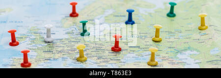 panoramic shot of colorful pins on world map - Stock Photo