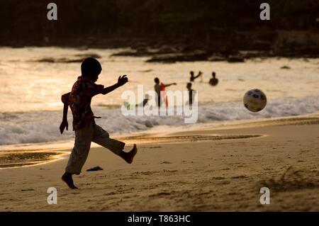 Cambodia, Sihanoukville or Preah Sihanouk,child playing football on the beach - Stock Photo