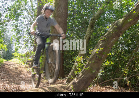 Boy doing jump on mountain bike - Stock Photo