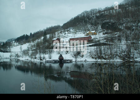 Southern Norway, remote village scene with reflection in river - Stock Photo