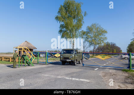 Chojniki, Belarus, - April 26, 2019: Entering the exclusion zone of Chernobyl accident area in Belarus contaminated with radioactive fallout in 1986. - Stock Photo