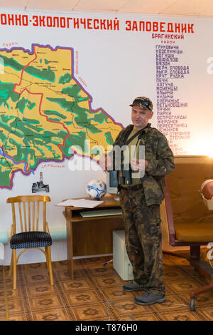 Chojniki, Belarus, - April 26, 2019: Guide telling the Chernobyl accident story in 1986 in the museum of the Belarus exclusion zone of Chernobyl. - Stock Photo