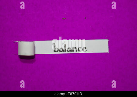 Balance, Inspiration, Motivation and business concept on purple torn paper - Stock Photo