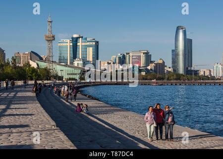 Azerbaijan, Baku, Bulvar Promenade, city skyine from Baku Bay with visitors - Stock Photo