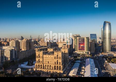 Azerbaijan, Baku, high angle skyline with Dom Soviet Government House, dusk - Stock Photo