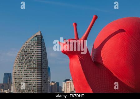 Azerbaijan, Baku, Trump Hotel and Tower and big red snail by the Heydar Aliyev Center - Stock Photo