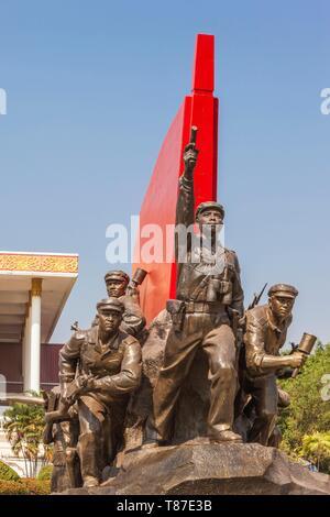 Laos, Vientiane, Kaysone Phomivan Museum, building exterior and revolutionary sculpture - Stock Photo