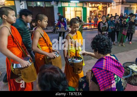 Laos, Luang Prabang, Tak Bat, dawn procession of Buddhist monks collecting alms - Stock Photo