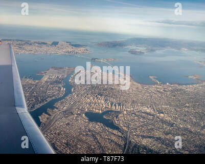 Our CRJ200 climbs out over Oakland California on its way north to Redding California - Stock Photo