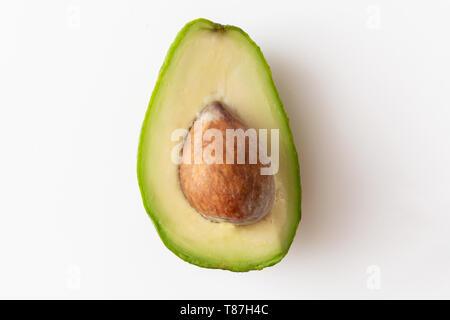 Macro shot of avocedo centered on white background, vegan food with healthy oils - Stock Photo