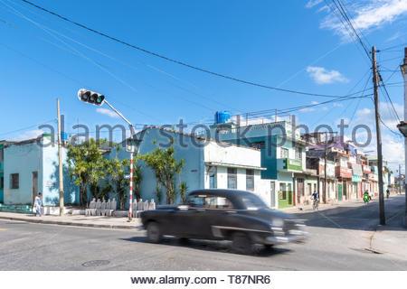 Santa Clara, Villa Clara, Cuba-May 5, 2019: Transportation in the Caribbean island. Motion blur of old vintage car on a city street during the daytime - Stock Photo