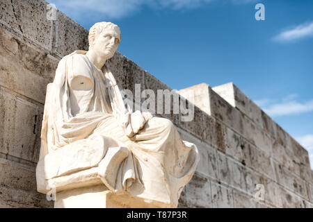 Honorary monuments of dramatic poets at the eastern parados at the Acropolis. The Acropolis of Athens is an ancient citadel standing on a rocky outcro - Stock Photo