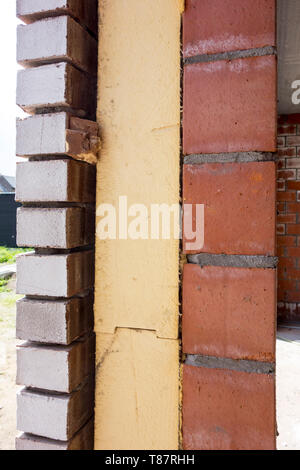 Close up of cavity wall insulation boards fitted in masonry cavities in newly built house used to reduce heat loss - Stock Photo
