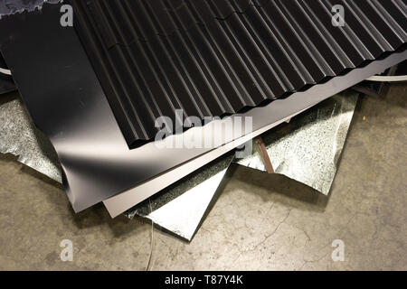 Scraps of metal on factory floor to be collected for recycling - Stock Photo