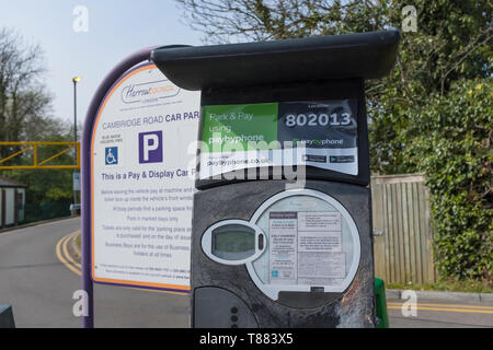 Parking machine in the car park of a London suburb. - Stock Photo