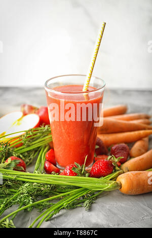 Glass of fresh tasty smoothie and ingredients on table - Stock Photo