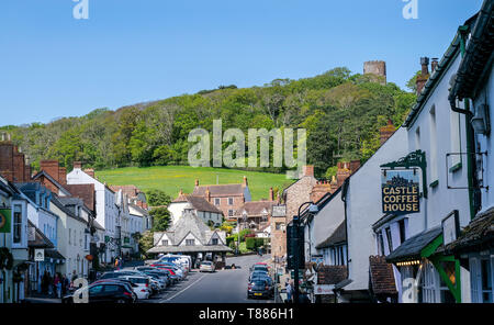 A view of Dunster village in Somerset, England, UK looking down the street away from the castle - Stock Photo