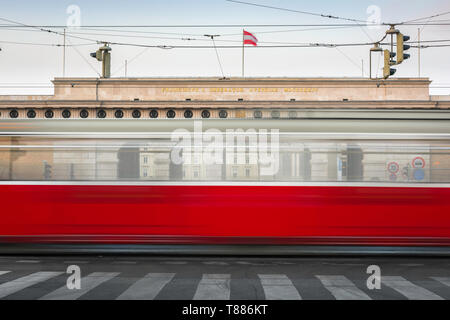 Vienna city transport, view of a tram on the Ringstrasse in Vienna speeding past the (Heldenplatz) entrance to the Hofburg Palace, Austria. - Stock Photo