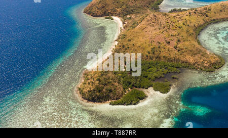 tropical island with coral reefs. Philippine Islands in clear weather aerial view.Philippines, Palawan - Stock Photo