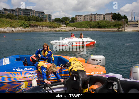 Journalist Tom Stone sets out for the start line in his first ever powerboat race. - Stock Photo