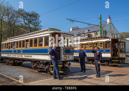 Douglas and Laxey Electric Tramway carriage alongside Snaefell Mountain Railway train in Laxey, Isle of Man - Stock Photo