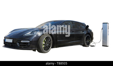 Luxury hybrid electric sports car vehicle charging at charging point cut out isolated on white background - Stock Photo