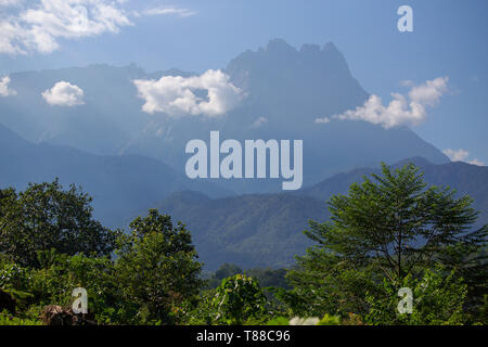 Mount Kinabalu, the highest mountain in South East Asia seen from Melangkap, Sabah Malaysia - Stock Photo