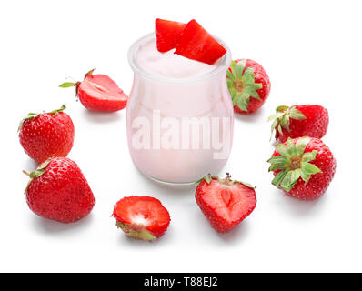 Glass jar with tasty yogurt and strawberries on white background - Stock Photo