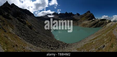 Teal waters of the Wildsee, first lake on the Pizol 5-lakes walk starting at the top, Swiss Alps - Stock Photo