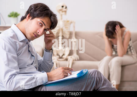 Young patient visiting psychologist for therapy - Stock Photo