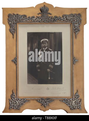 An important portrait photo of Tsar Nicholas II With handwritten signature in ink, Russia, dated 'Swinemünde 1907'. On the right edge embossed signature of the court photographer 'C. E. de - Hahn & Co. - Tzarskoe Selo'. Slightly blotched. Under glass, in lacquered birch wood frame with silver, finely engraved Russian style mounts. Under the applied Tsar crown kokoshnik head mark, on the stylised double eagle St. Petersburg hallmark for '84' zolotniki and master mark 'A.B' for 'Andrey Bragin'. Below the stand the label 'Privat Archiv Paul v. Hintz, Additional-Rights-Clearance-Info-Not-Available - Stock Photo