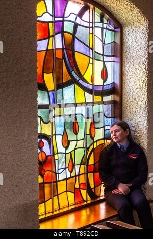 Dungloe, St Crona's Church, County Donegal, Ireland. 11th May 2019. Emma Fleury sits in the chapel before her confirmation service. Credit: Richard Wayman/Alamy Live News - Stock Photo