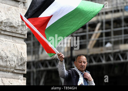 London, Greater London, UK. 11th May, 2019. A protester is seen holding a Palestinian flag during the demonstration.Palestinian human rights activist Ahed Tamimi joined the National demo for Palestine. Protesters gathered at Portland Place and marched to Whitehall in London, joining a global demonstration to show solidarity for Palestinian citizens and also to demand respect for the Palestinians rights and defend the rights to return to their territory. Credit: Andres Pantoja/SOPA Images/ZUMA Wire/Alamy Live News - Stock Photo