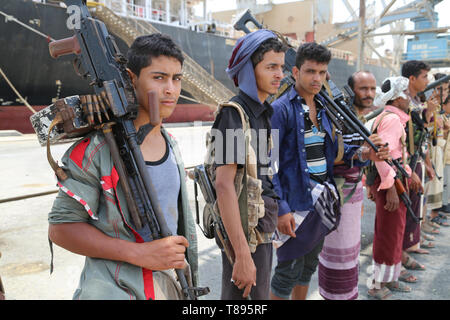 (190511) -- HODEIDAH (YEMEN), May 11, 2019 (Xinhua) -- Houthi members are seen during their withdrawal from Salif port in Hodeidah, Yemen, on May 11, 2019. Yemen's Houthi rebels began on Saturday withdrawal from two ports of Hodeidah Province, eyewitnesses said. (Xinhua) - Stock Photo