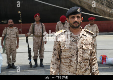 (190511) -- HODEIDAH (YEMEN), May 11, 2019 (Xinhua) -- Houthi members stand at attention during their withdrawal from Salif port in Hodeidah, Yemen, on May 11, 2019. Yemen's Houthi rebels began on Saturday withdrawal from two ports of Hodeidah Province, eyewitnesses said. (Xinhua) - Stock Photo
