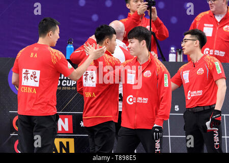 Beijing, China. 12th May, 2019. Team China celebrate ahead of the 2018-2019 WCF Curling World Cup Grand Final men's final between China and Canada 2 at the Shougang Ice Hockey Arena in Beijing, capital of China, May 12, 2019. China lost 3-5 and won the silver. Credit: Chen Yichen/Xinhua/Alamy Live News - Stock Photo