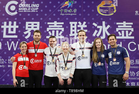 Beijing, China. 12th May, 2019. Team Norway (C), Team Canada 1 (L) and Team the United States pose at the awarding ceremony of the 2018-2019 WCF Curling World Cup Grand Final mixed doubles event at the Shougang Ice Hockey Arena in Beijing, capital of China, May 12, 2019. Credit: Luo Yuan/Xinhua/Alamy Live News - Stock Photo