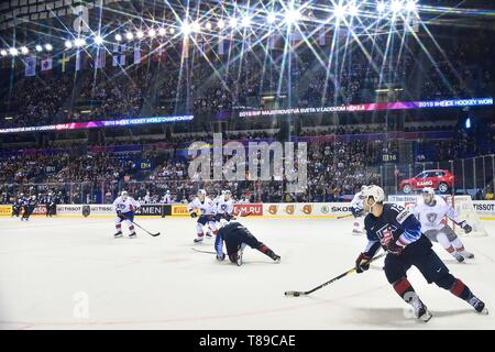 Kosice, Slovakia. 12th May, 2019. Alex DeBrincat(Front) of USA controls the puck during the 2019 IIHF Ice Hockey World Championship Slovakia group A game between USA and France at Steel Arena on May 12, 2019 in Kosice, Slovakia. Credit: Lukasz Laskowski/Xinhua/Alamy Live News - Stock Photo