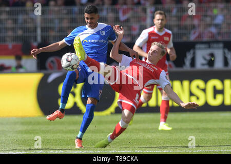 Berlin, Germany. 12th May, 2019. Soccer: 2nd Bundesliga, 1st FC Union Berlin - 1st FC Magdeburg, 33rd matchday. Magdeburg's Tarek Chahed (l) and Unions Joshua Mees in a duel. Credit: Jörg Carstensen/dpa - IMPORTANT NOTE: In accordance with the requirements of the DFL Deutsche Fußball Liga or the DFB Deutscher Fußball-Bund, it is prohibited to use or have used photographs taken in the stadium and/or the match in the form of sequence images and/or video-like photo sequences./dpa/Alamy Live News - Stock Photo