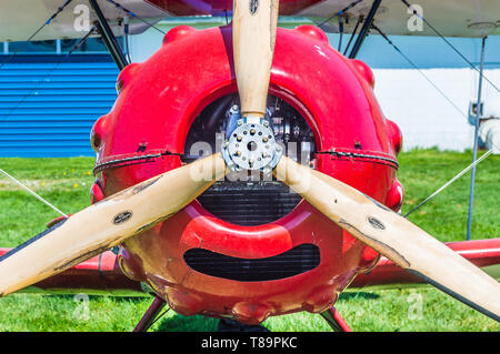 Propeller and nose of red vintage Murphy Renegade bi-plane at Delta Heritage Airpark. - Stock Photo