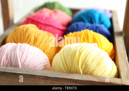 Wooden basket with balls of knitting yarn, closeup - Stock Photo