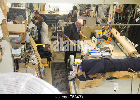 Perth, Western Australia, Australia - 17/01/2013 : People working in a clothing repair company with leather, Sinikka Custom Made Garments, Alteration - Stock Photo