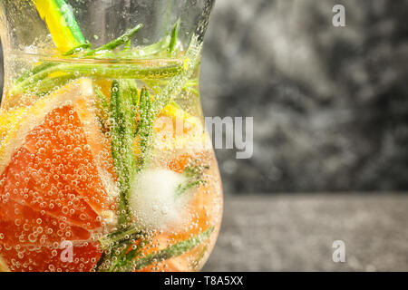 Fresh grapefruit cocktail with rosemary in glass, closeup - Stock Photo