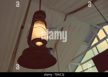 Close up yellow lamp in cafe at night - Stock Photo