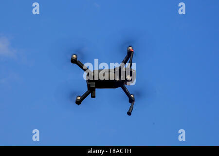 DJI Mavic Pro campact drone flying under the sky of Dhaka. Bangladesh - Stock Photo