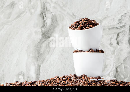 Black coffee in cup and coffee beans on marble background. Top view, space for text - Stock Photo