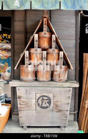 Yanaka, Tokyo, Japan - 12th July 2018 : View of some typical stacked wooden water buckets that were use to putting out fires. This is located in the Y