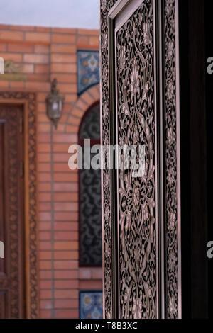 Carved wooden doorway of Ichan Qal'a Premium Class Hotel in the city of Tashkent capital of Uzbekistan - Stock Photo