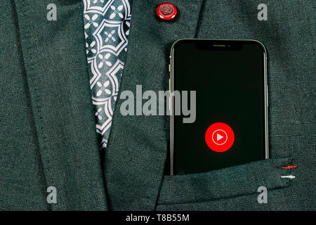 Sankt-Petersburg, Russia, August 24, 2018: YouTube Music application icon on Apple iPhone X smartphone screen close-up in jacket pocket. Youtube music - Stock Photo